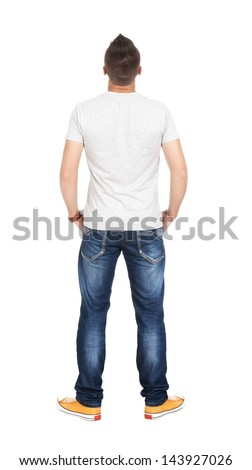 Back view of young men in t-shirt and jeans. Guy looks away. Rear view people collection. backside view of person. Isolated over white background. - stock photo
