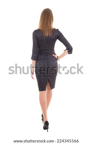 back view of young slim woman in dress isolated on white background - stock photo