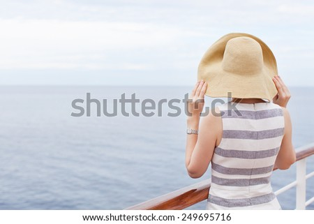 back view of young woman at cruise ship - stock photo