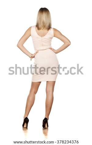 back view of young woman in tight short dress  - stock photo