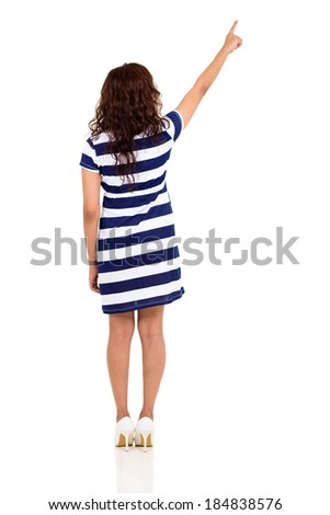 back view of young woman pointing up isolated on white background - stock photo
