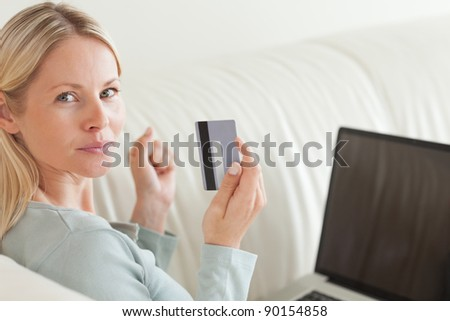 Back view of young woman shopping online - stock photo