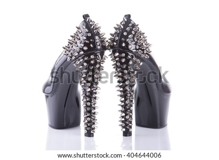 Back view on black high heel shoes with spikes, isolated on white background