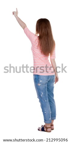Back view pointing woman. beautiful redhaired  girl .Rear view people collection.  backside view person.  Isolated over white background. Girl in white T-shirt points a finger at something interesting - stock photo