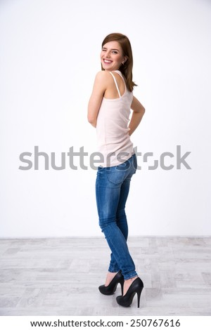 Back view portrait of a happy woman winking at camera - stock photo