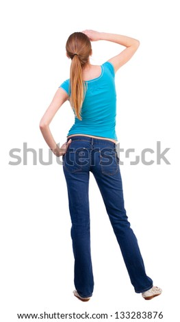 back view standing young beautiful  blonde woman. girl  watching. Rear view people collection.  backside view of person. she curiously looks up.  Isolated over white background. - stock photo