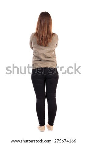 back view standing young beautiful  woman in jeans.  Rear view people collection.  backside view of person.  Isolated over white background. Girl standing with her hands folded on his chest.