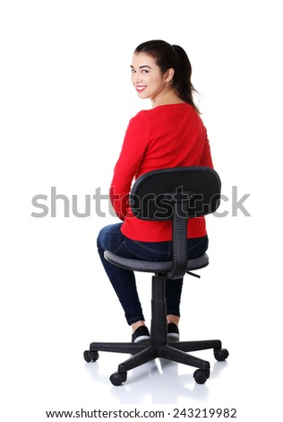 Back view student woman siting on armchair. - stock photo