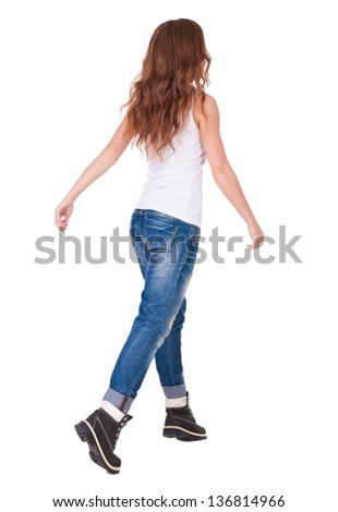 back view walking woman . beautiful redhead girl in motion.  backside view of person.  Rear view people collection. Isolated over white background. Stylish teenage girl in boots and vest goes forward. - stock photo