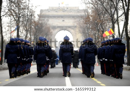 Back view with troops march during a military parade - stock photo