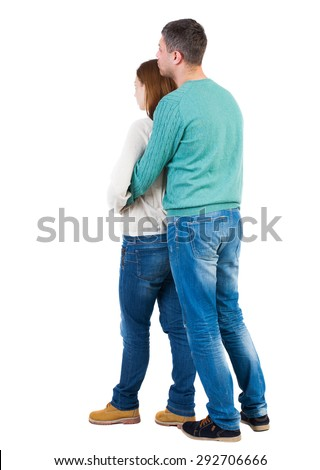 Back view young embracing couple (man and woman) hug and look into distance  backside view person. Isolated over white background. man and woman are closely prishavshis to each other and looking ahead - stock photo