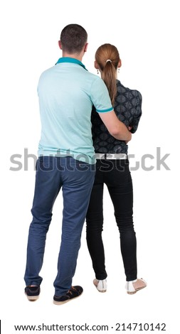 Back view young embracing couple (man and woman) hug and look into distance. beautiful friendly girl and guy together. Rear view people collection. backside view person. Isolated over white background