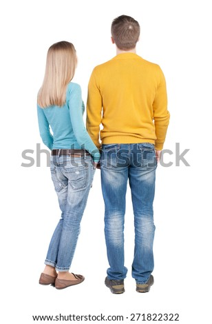 Back view young embracing couple (man and woman) hug and look into distance. beautiful friendly girl and guy together. Rear view people collection.  backside of person. Isolated over white background.