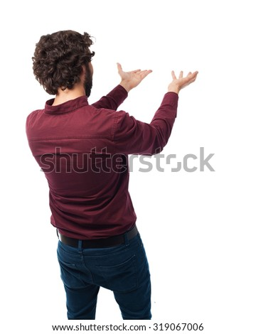 back young man showing - stock photo