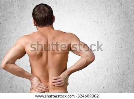Backache. - stock photo