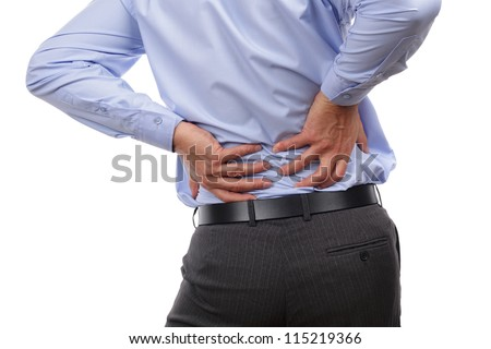 Backache concept bending over in pain with hands holding lower back - stock photo