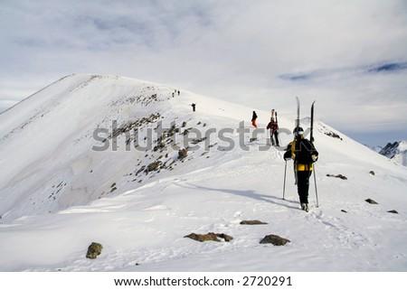 Backcountry in Gudaury, Georgia. Skiers, climb high mountain - stock photo