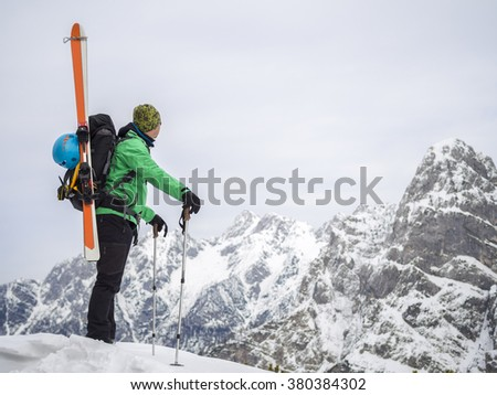 backcountry skier with his gear, high mountains in the background, Alps in Slovenia