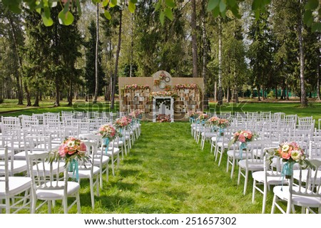 backdrop flowers arrangement and books for wedding ceremony - stock photo