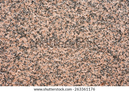 Backdrop of a red smooth granite wall. This horizontal empty stone surface is perfect as copy space or textured background.  - stock photo