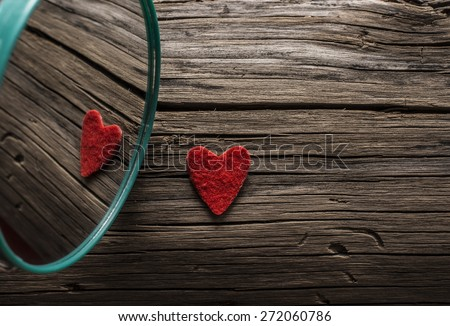 Backdrop of two red hearts lie on old retro vintage aged grunge style background . Valentine's day. Reflection in circle mirror Couple of sign love Idea symbol concept reciprocity, mutually - stock photo