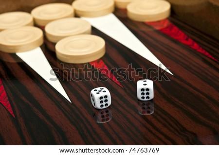 Backgammon table and dice closeup - stock photo