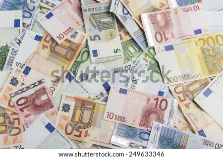 backgound of lots of bills of mixed value of euro - stock photo