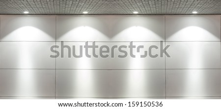 Backgroun of Empty white wall with 4 spot lights and gray stones brick floor - stock photo