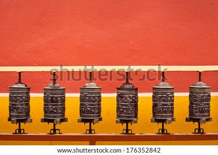 background about buddhism, prayer mills in buddhist monastery - stock photo