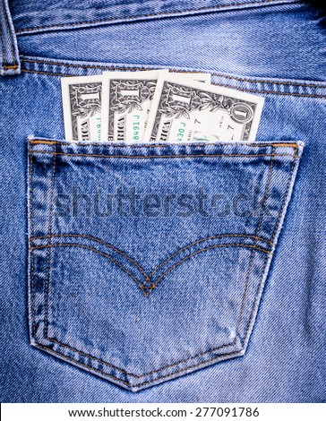 Background and texture of small money,currency,dollar in jeans pocket - stock photo