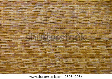 Background bamboo woven basket, a container of old, which is an ancient rural crafts. - stock photo