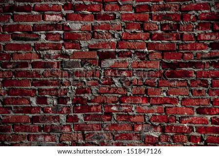 Background based on the brickwork of the cracked and weathered stained rough brick. - stock photo