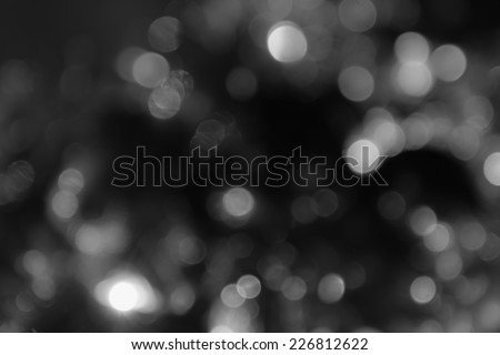 background black abstract bokeh for Christmas night light holiday - stock photo