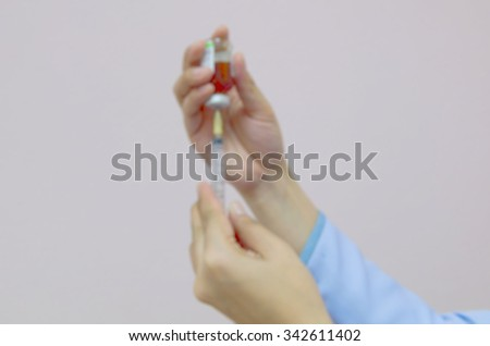 background blur nurse preparing injection with a syringe for the hospital patients who were treated in hospital. - stock photo