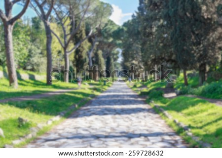 Background blur of the Appian Way, the Via Appia Antica, in Rome, Italy. - stock photo