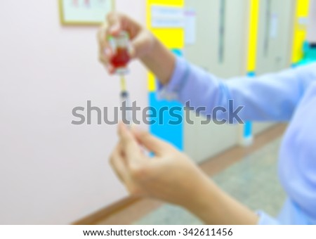 background blur soft focus nurse preparing injection with a syringe for the hospital patients who were treated in hospital. - stock photo