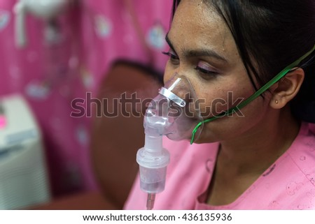 Background blur The patients with chronic cough racers should be treated by the oxygen inhaler. - stock photo