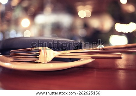 background blurred restaurant table setting - stock photo