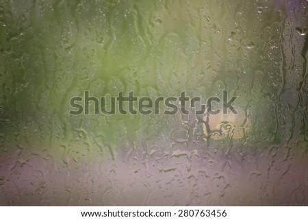background blurred through the glass rain - stock photo