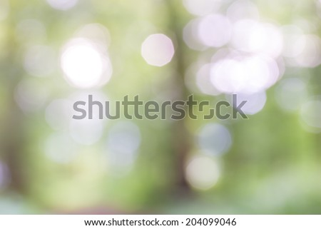 Background bohek of defocused sparkling light over an ethereal blurred green backdrop for a dreamy spiritual effect. - stock photo