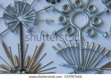 Background: bolts, nails, screws, nuts, dowels - stock photo