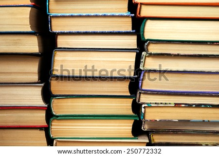 background books stacked in piles - stock photo