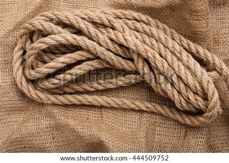Background brown burlap and brown thick rope