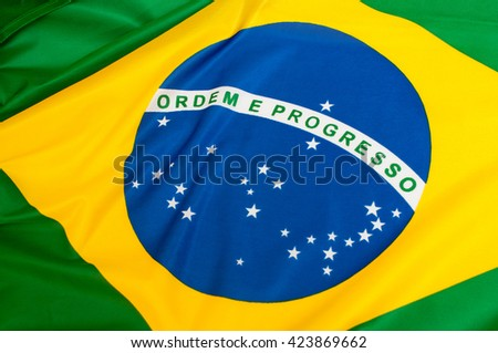 Background - Close up of the silky Brazilian flag - stock photo