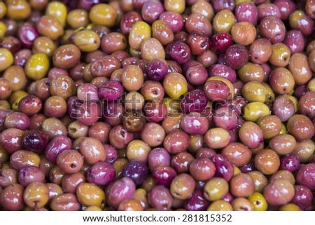 background close-up shot of olives on the eastern market - stock photo
