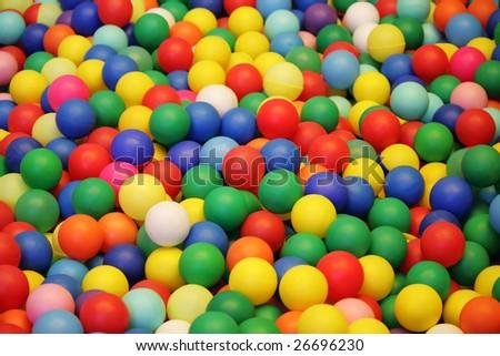 Background, colorful plastic balls on children's playground - stock photo