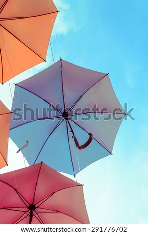 Background colorful umbrella against blue sky - stock photo