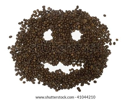 Background combined from coffee grains on a white background. Big smile