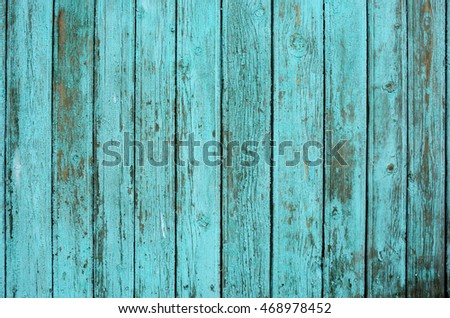 background consisting of old wooden boards with traces of peeling paint. partially tinted photo.