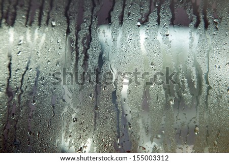 background consisting of wet windshield with rain drops - stock photo